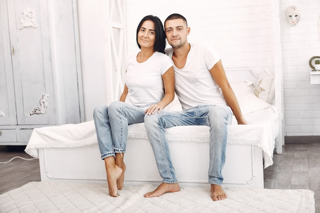 Beautiful couple spend time in a bedroom Free Photo
