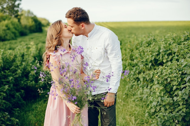 Beautiful couple spend time on a field Free Photo