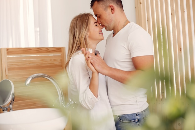 Beautiful couple spend time in a kitchen Free Photo