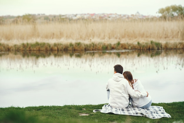 Beautiful couple spend time in a spring forest Free Photo