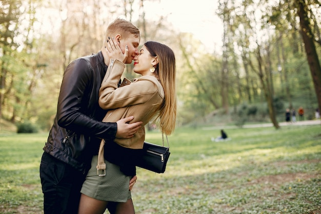 Beautiful couple spend time in a spring park Free Photo