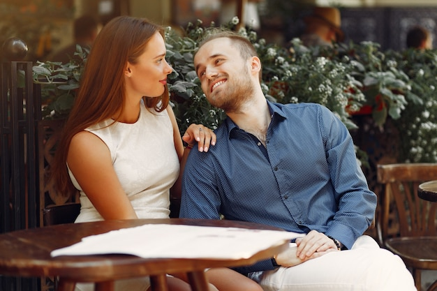 Beautiful couple spend time in a summer city Free Photo