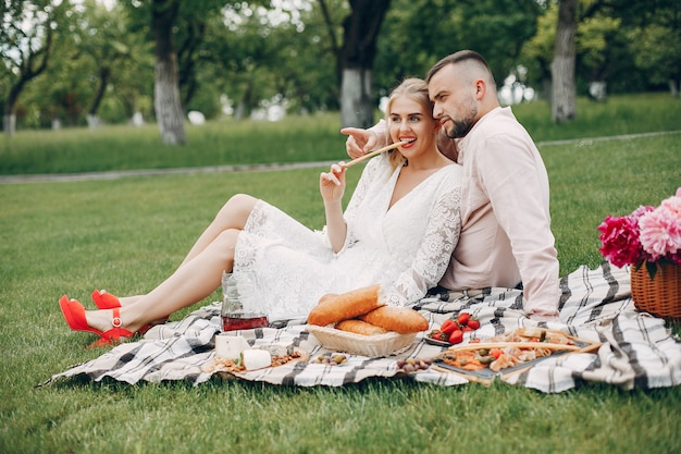 Beautiful couple spend time in a summer garden Free Photo