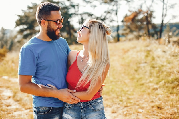 Beautiful couple spend time in a summer park Free Photo