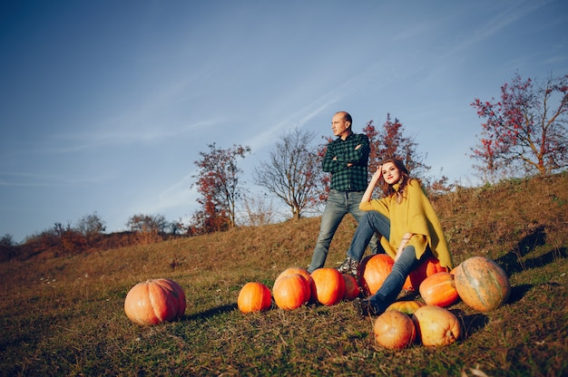 Beautiful couple spends time in an autumn park Free Photo