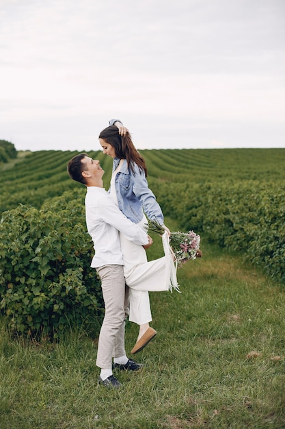 Beautiful couple spends time on a summer field Free Photo
