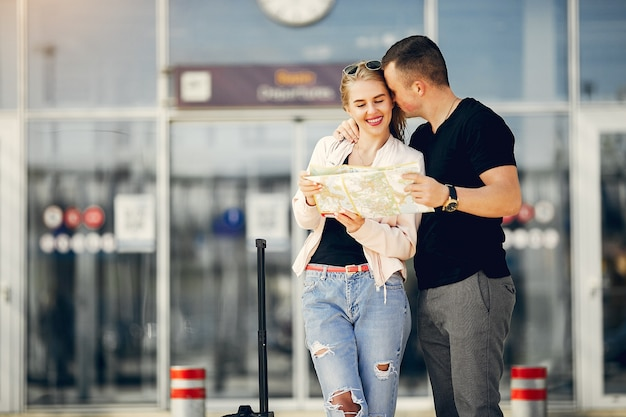 Beautiful couple standing in airport Free Photo