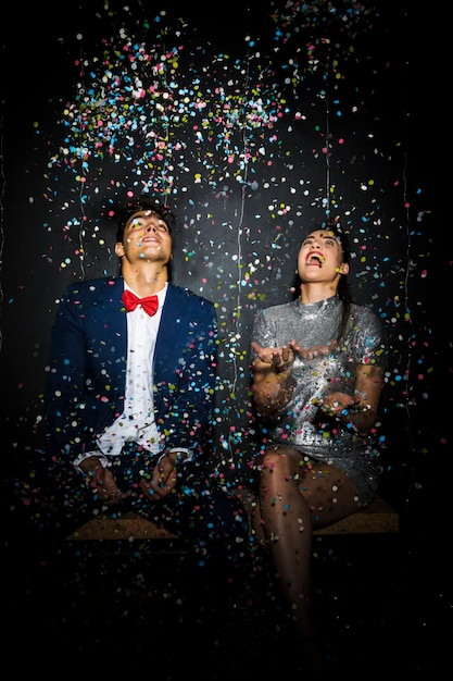 Beautiful couple between tossing confetti Free Photo