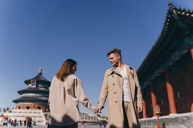 Beautiful couple very much in love exploring china on their honeymoon Free Photo