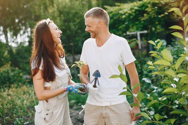 Beautiful couple works in a garden Free Photo