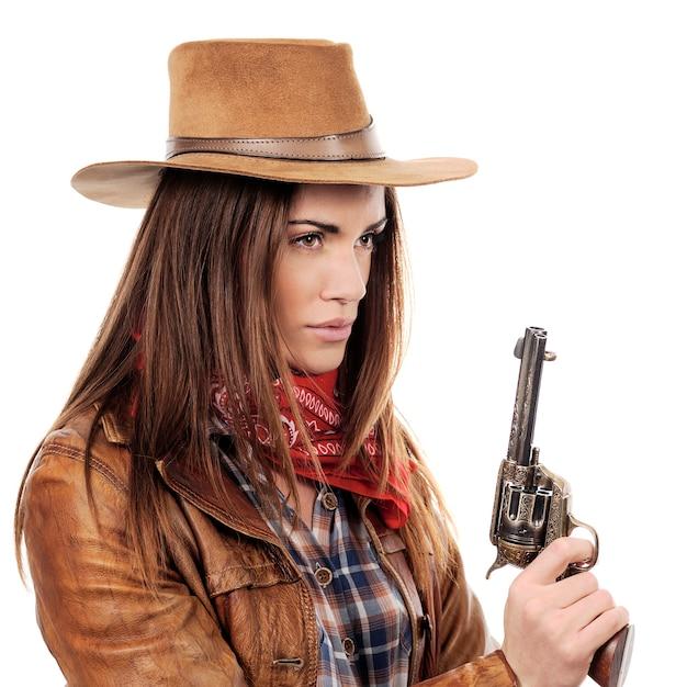 白い背景の上の銃を持つ美しい騎乗位 無料写真