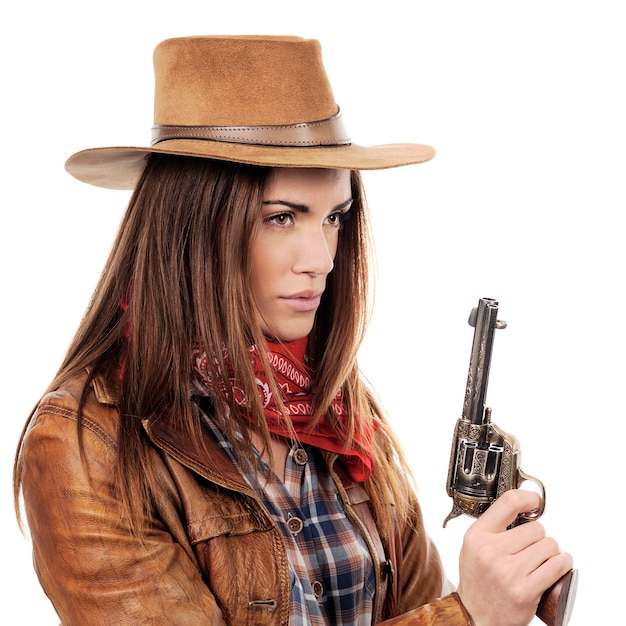 Beautiful cowgirl with gun on white background Free Photo