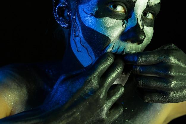 Beautiful creepy girl with skeleton makeup Premium Photo
