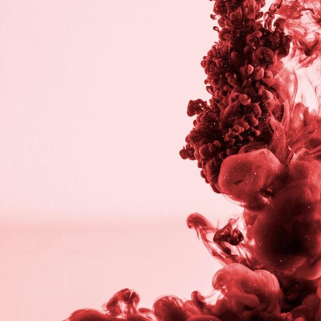 Beautiful dark red cloud of ink Free Photo