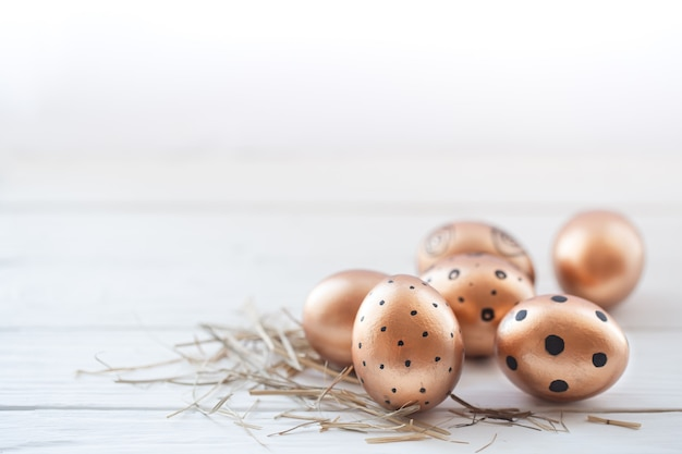 Beautiful decorated easter eggs of golden color . Free Photo
