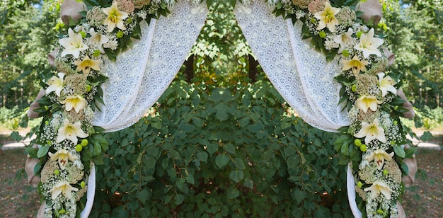 Beautiful decorated wedding arch for the ceremony outdoor Premium Photo