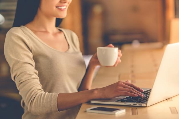 Beautiful designer drinking coffee. Premium Photo