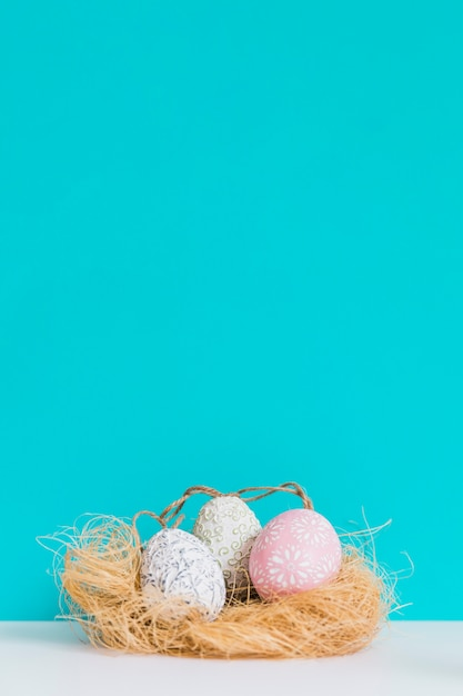 Beautiful easter eggs in nest Free Photo