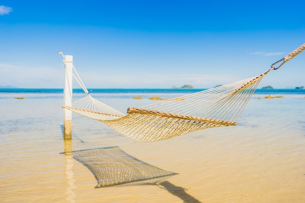 Beautiful empty hammock around tropical beach sea ocean for holiday vacation Free Photo