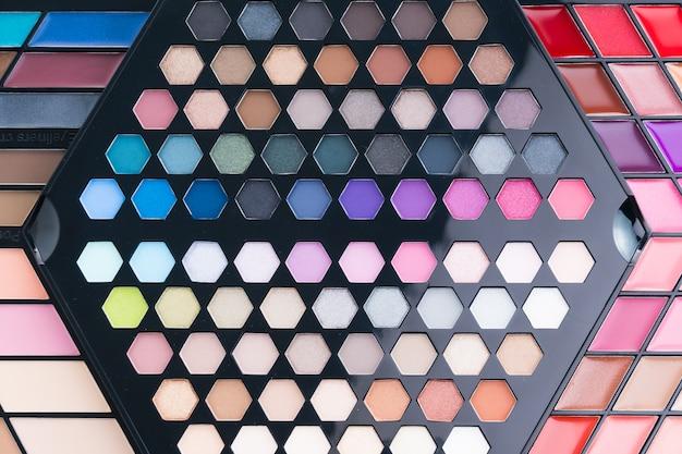 Beautiful eye shadow and lip gloss cosmetic Free Photo