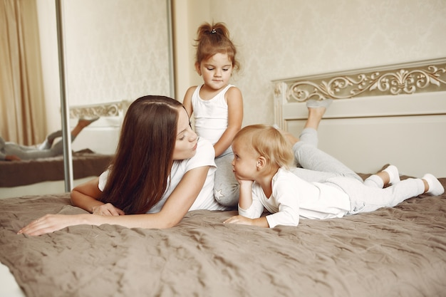 Beautiful family spend time in a bathroom Free Photo