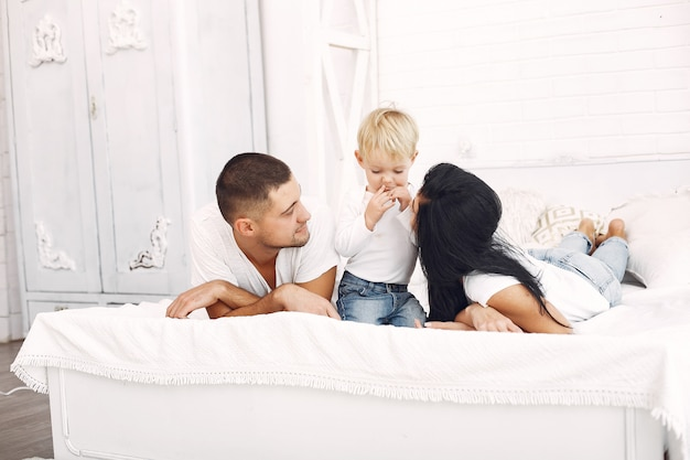 Beautiful family spend time in a bedroom Free Photo