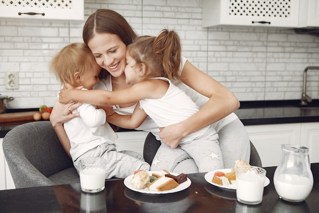 Beautiful family spend time in a kitchen Free Photo