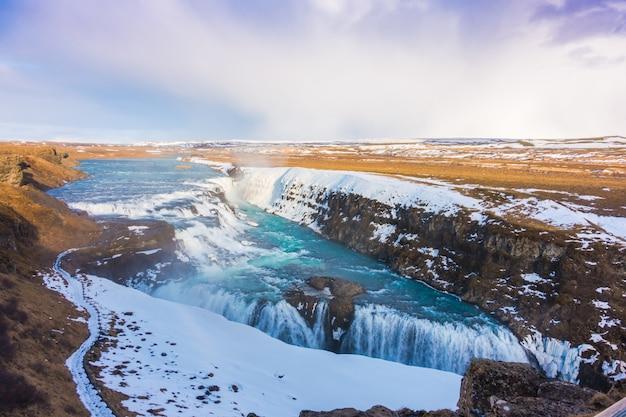 Beautiful famous waterfall in iceland, winter season . Free Photo