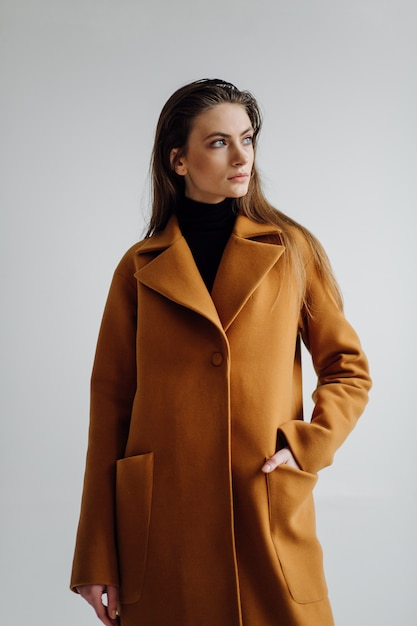 Beautiful fashion woman posing with elegant suit Free Photo