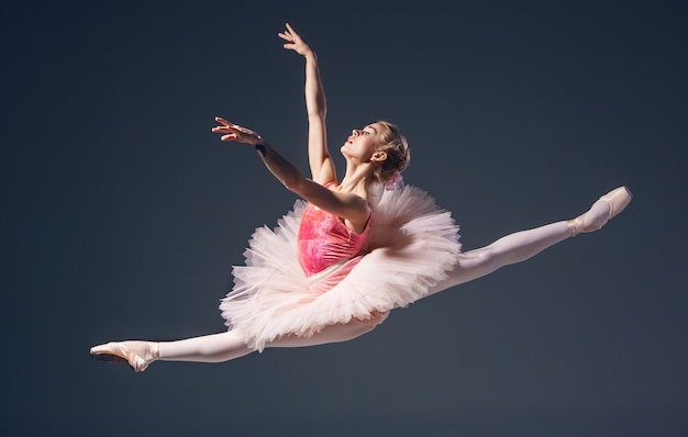 Beautiful female ballet dancer on a grey background Free Photo