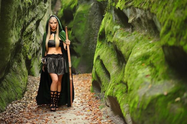 Premium Photo   Beautiful female elf archer in the forest