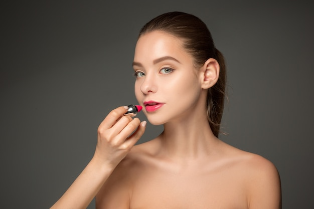 Beautiful female lips with make-up and brush Free Photo