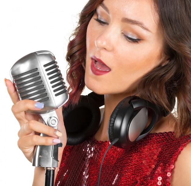 Beautiful female singer singing a song Premium Photo