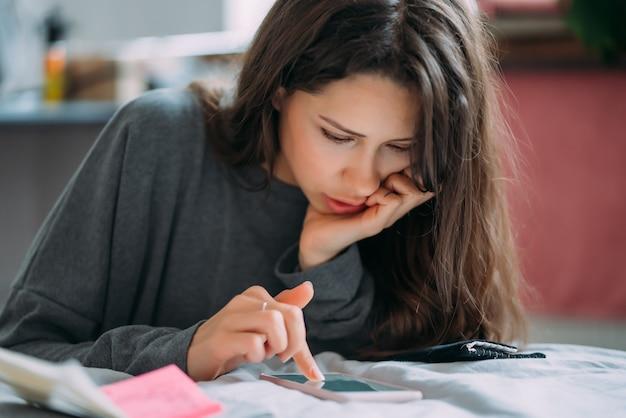 Beautiful female student preparing for upcoming examination. Free Photo