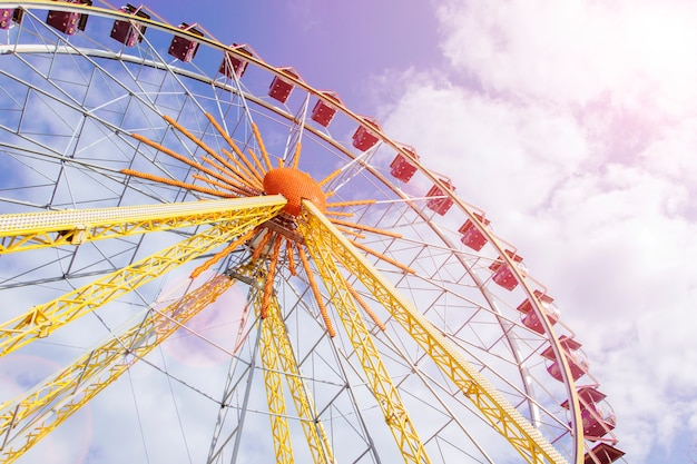Beautiful ferris wheel on the background of  sunny sky Premium Photo