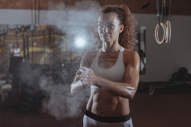 Beautiful fit crossfit woman exercising Premium Photo