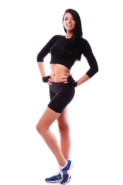 Beautiful fitness girl posing over white background Free Photo