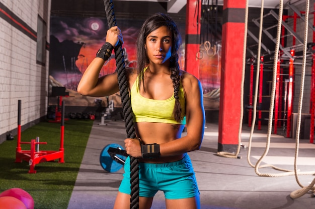 Beautiful fitted girl at gym with black rope Premium Photo