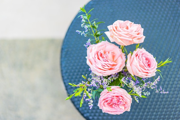 Beautiful flower in vase on table decoration with garden view Free Photo