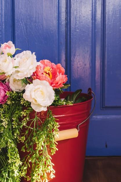 Beautiful flowers in bucket   Free Photo
