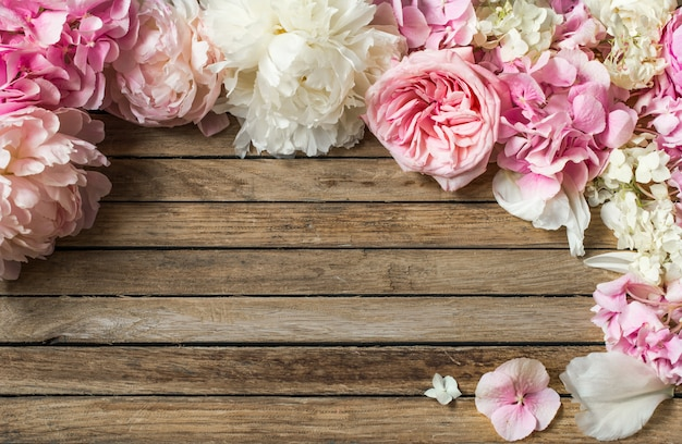 Beautiful flowers on wooden background Free Photo