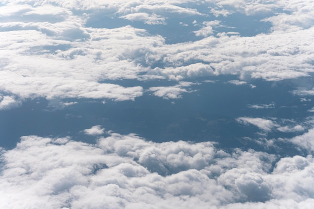 Beautiful fluffy clouds seen from airplane Free Photo