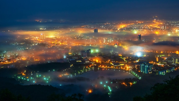 Beautiful fog over the city at night Premium Photo