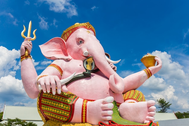 Beautiful ganesh statue on blue sky in temple Premium Photo