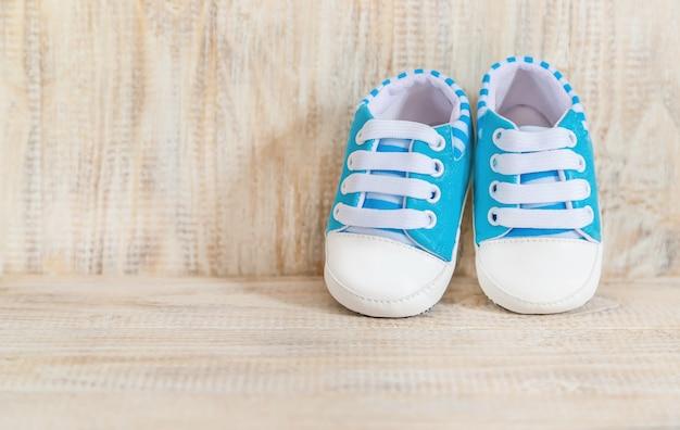 Beautiful gentle background, accessories newborn baby. selective focus. Premium Photo
