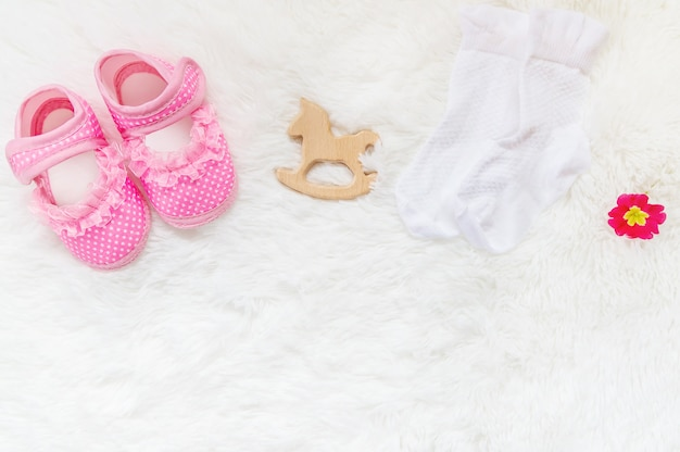 Beautiful gentle background, accessories newborn baby. selective focus. Premium Photo