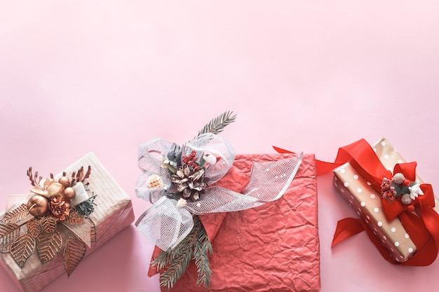 Beautiful gift holiday box on a pink background Free Photo