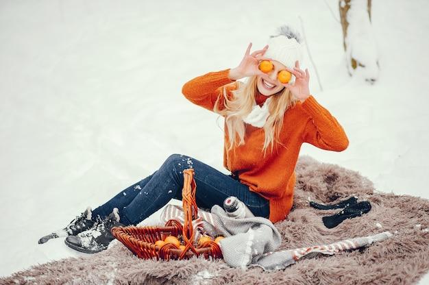 Beautiful girl in a cute orange sweater Free Photo