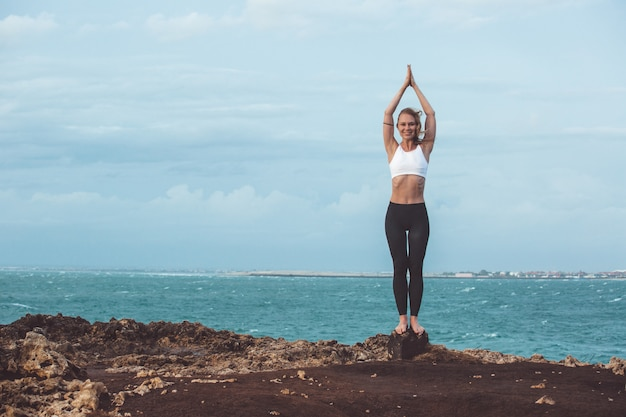 Beautiful girl doing yoga Free Photo