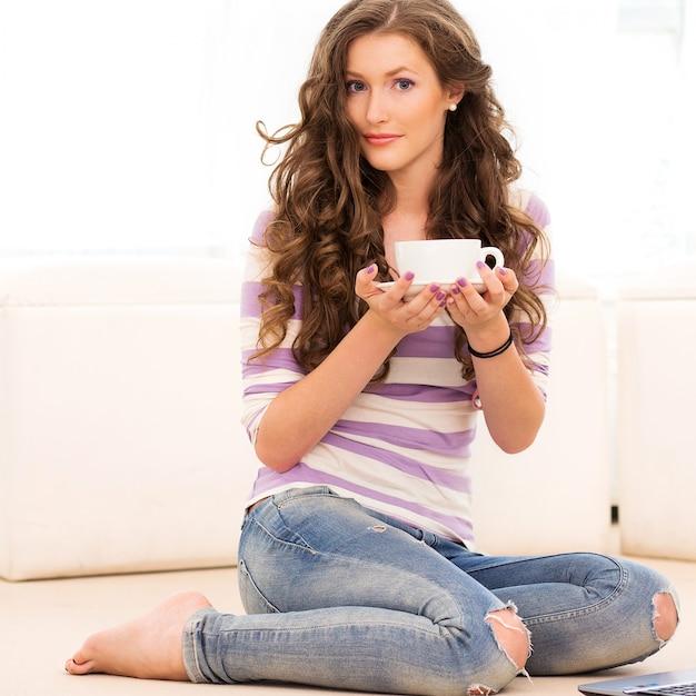 Beautiful girl drinking coffee Free Photo